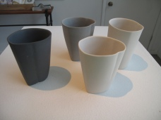 3 different color porcelain with cups at the damn studio.